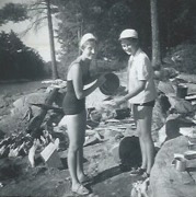 Two women in front of a camp site