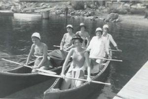Six women in two canoes