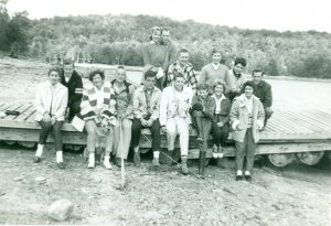 A group of people sitting on a beached dock
