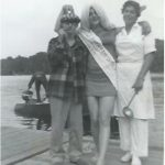 Young people in costumes on a dock