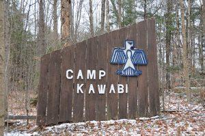Sign for Camp Kawabi with thunderbird icon