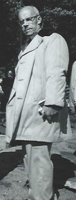 Ronald Perry wearing trenchcoat