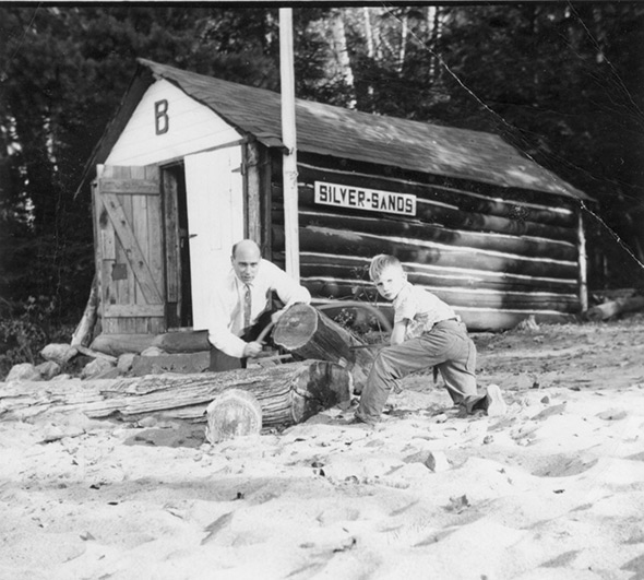 Two people building a boathouse