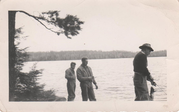 Men with fishing rods on the shore