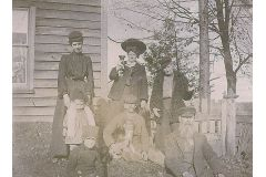 people posing in front of a house