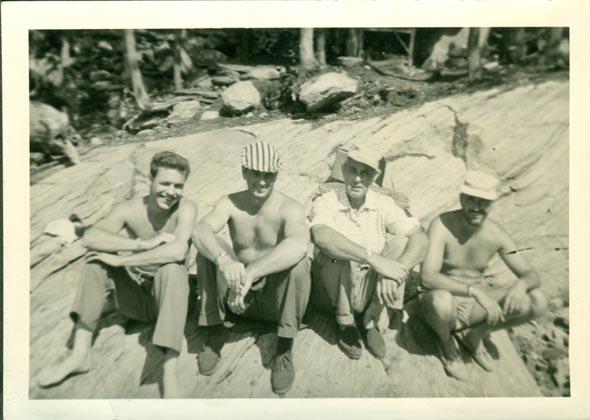 men on a rock